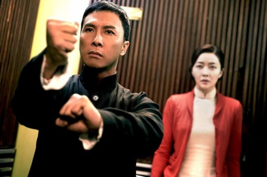 Ip Man defends his cancer stricken wife (background, right) against a hired assailant in one of the films more exhilarating and creative sequences