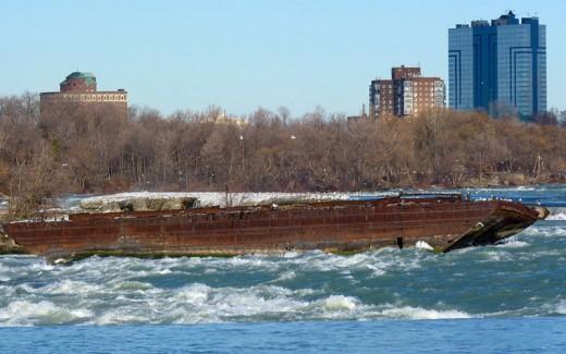 Though it has deteriorated, the old scow is still where it stopped in 1918.