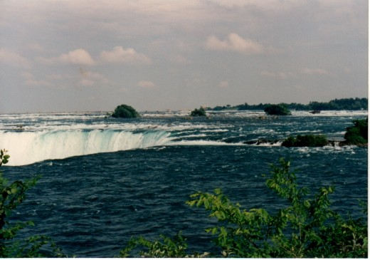Viewing from the shore, the falls to the left, the scow up to the right.