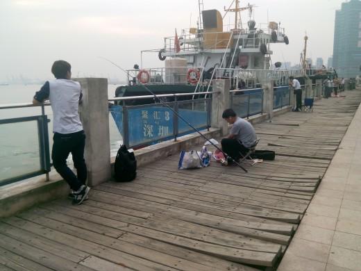 Friday afternoon fishing at Shekou Docks, Shenzhen, China