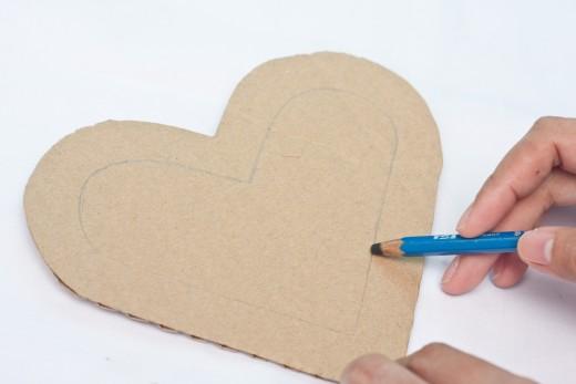 Draw a smaller heart inside the cardboard heart