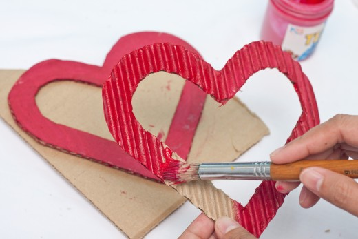 Get the red paint and paintbrush and paint both your hearts red.  Let them dry completely.