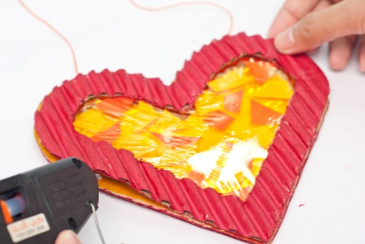 Glue the second heart on top of the yellow cellophane.