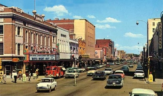 Central Avenue, Great Falls, Montana, 1962. Look close, on the right side, and you'll see Kaufman's sign.