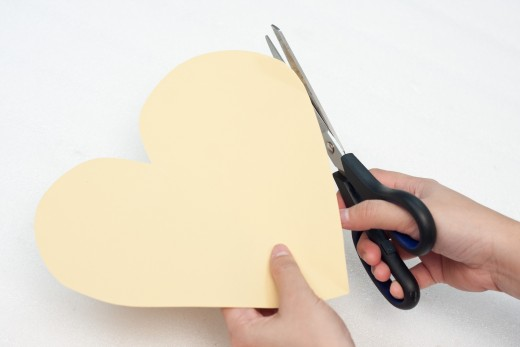Cut a heart shape out of the beige construction paper.