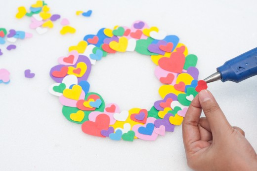 Keep gluing foam hearts onto the cardboard wreath until it is completely covered.  Looks great, doesn't it?