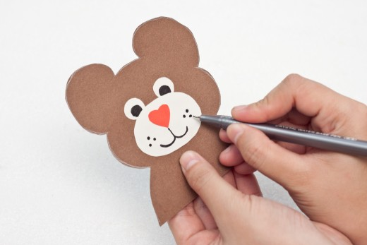 Draw a mouth, some whiskers, and some eyes on your Teddy Bear craft