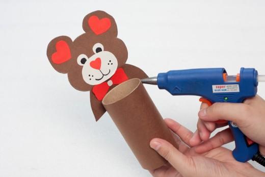 Glue your Teddy Bear to the cardboard craft roll