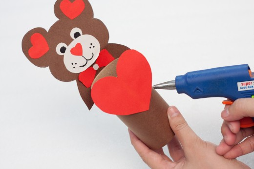 Glue the heart to the cardboard craft roll