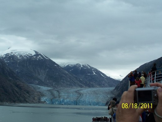 NOTICE THE DIRT THE GLACIER BROUGHT WITH IT DOWN THE MOUNTAIN