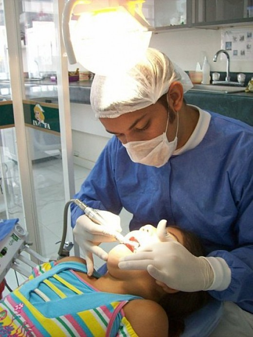 A dentist working on a patient