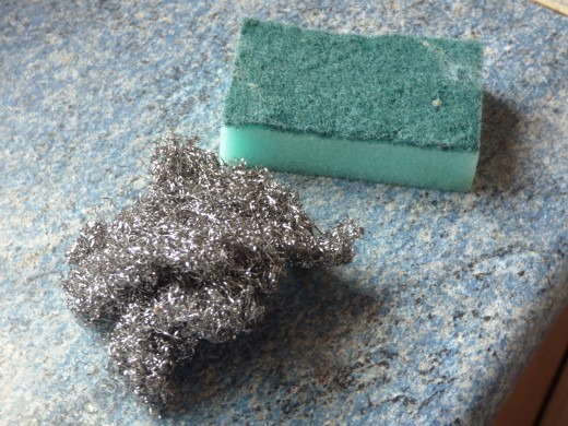 You see the actual scourer and sponge I used. The scourer had been used previously for pans etc so it doesn't reflect the amount of scrubbing I did. The sponge? You can hardly see the dirt. It rinsed down the drain forever...