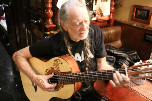 One of the few photos of Willie Nelson you will ever see with him playing a guitar other than trigger.