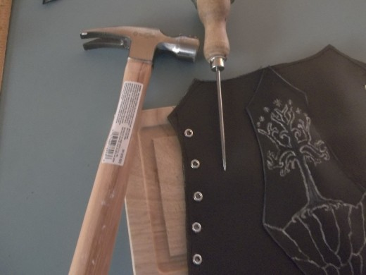 The Hammer and Awl method.  You may want to use a cutting board to protect your work surface like I did.