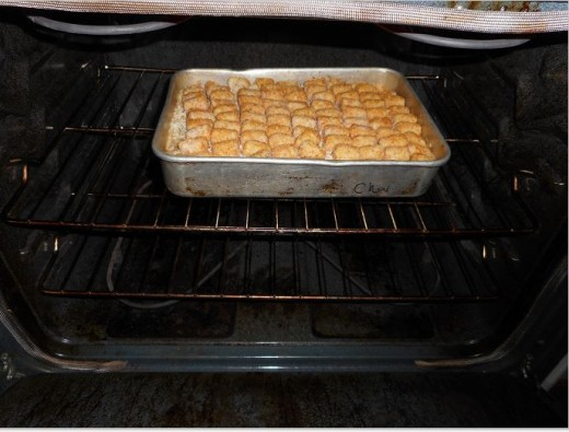 Oven 350 for hour and then, turn pan and continue heating until sauce has merged around tater tots.