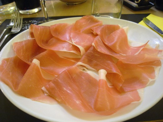 "This photo of prosciutto was taken by ""Prosciutto di Parma - affettato2"" by Sun Taro - originally posted to Flickr as R0011915. Licensed under CC BY-SA 2.0 via Commons - https://commons.wikimedia.org/wiki/File:Prosciutto_di_Parma_-_affettato2.jpg#/m"