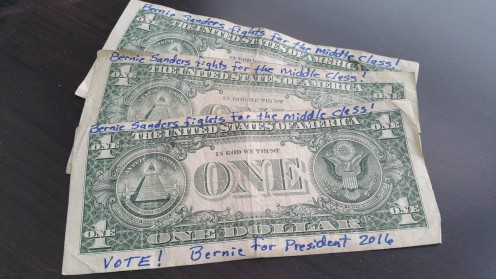 As you can see, writing the slogans works fine on ones, fives, tens, twenties and up. I don't ever have the larger denominations, but maybe you get those for paying your bills.  It looks like she used an ordinary ink pen for this example.