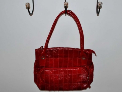 Woman red handbag hanging on the hanger