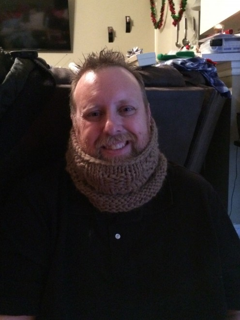 My husband modeling his Christmas cowl made in baby grande alpha yarn!