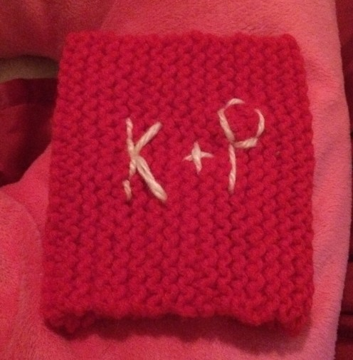 This is the monogrammed coffee cozy I made for my husband from the kitties, King and Princess - hence the K and P. :)