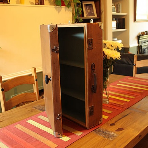 Wall cabinet made with wooden French suitcase