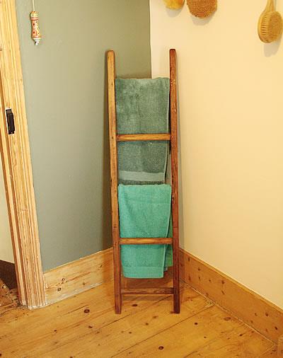 Upcycled wooden ladder towel holder