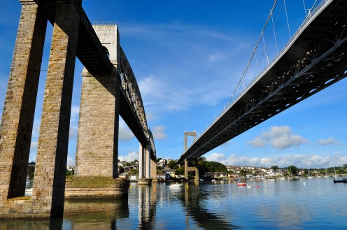 The Royal Albert Bridge carries the railway into Cornwall and the Tamar Bridge is a road bridge.