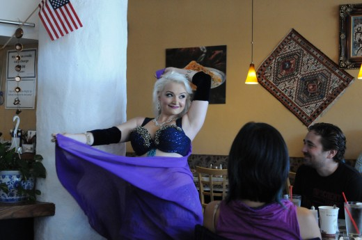 When performing, belly dancers must consider their audience.  In a restaurant setting, the audience will want something fun and uplifting.