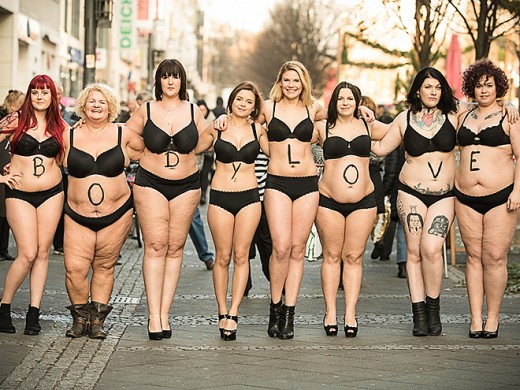 Women Pose in Lingerie at an event for the #Bodylove Campaign in Germany. Men and Women both participate in the event.