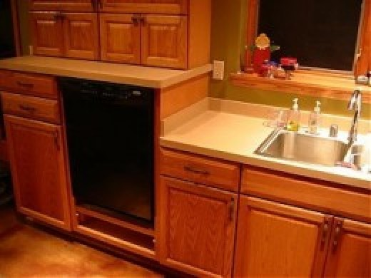 The combination of a raised dishwasher and lowered sink significantly reduces back strain.
