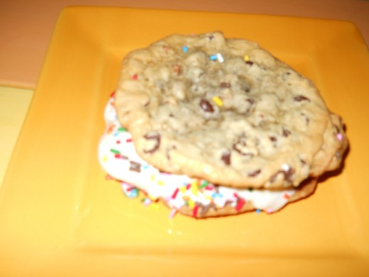 Put vanilla ice cream between two cookies and roll in  candy sprinkles. This make a tasty treat for a hot summer day. Kids love them.