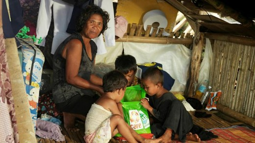 A family survives typhoon Haiyan in Tacloban.