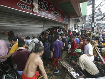 Looting at a Tacloban store after Haiyan.