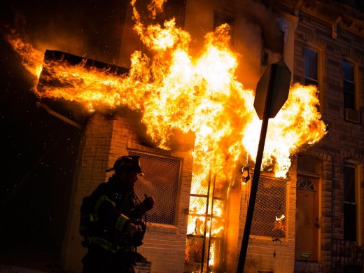 Police and Firemen respond to a burning store at the Baltimore riots.