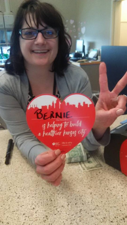 Here's the bank teller with the heart to post in the window. If you're making a donation, use Bernie Sanders' name which gives him some additional exposure.