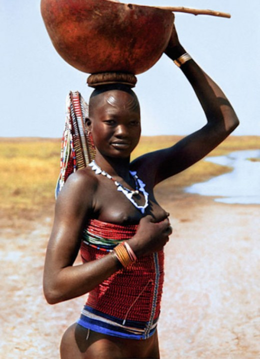 Dinka tribe in Sudan with her native wearables.