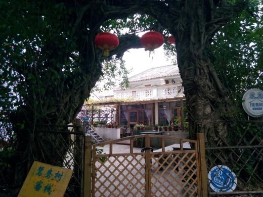 Gateway to bars and accommodation at Xichong Beach Resort