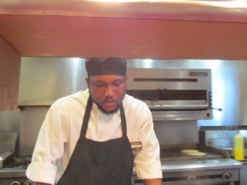 Chef Abdullah, prepares special orders for breakfast at the Tenth Floor Grill.