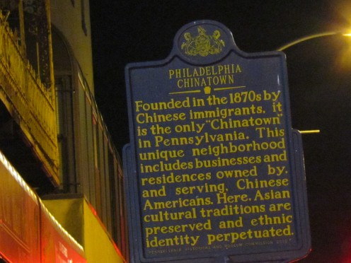 A plaque that mentions how Chinatown was established in the 1870's by Chinese immigrants.