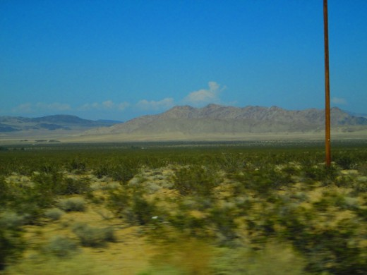 Mountains are visible to the north of SR 247.