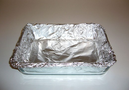 Before you start, prepare your tray by lining it with parchment paper or aluminum foil.  Your tray should be approximately 5x6 inches, and about 1 inch deep.  Takeout containers or microwave meal trays are a good size and work well for this.