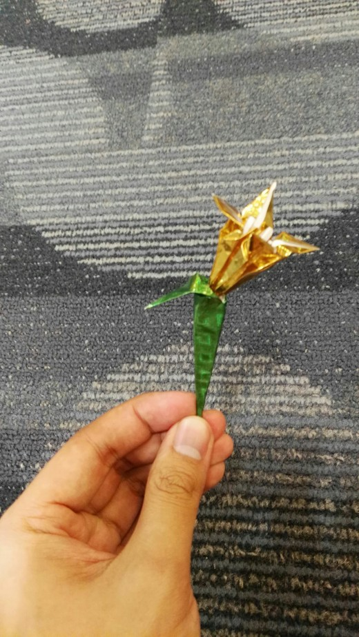 3D origami flower (lily) with stalk and leaf.