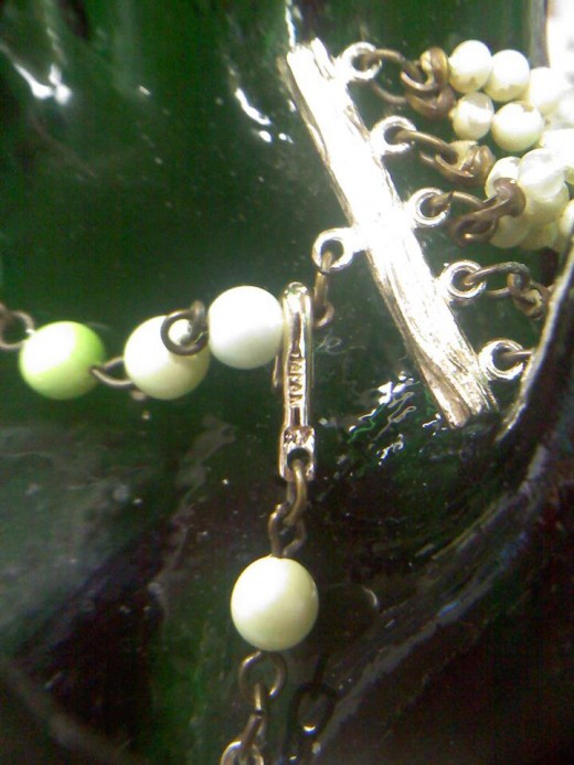 A Blurry Image of the Marking on the Necklace in the Jewelry Set Above.  This photo goes with number two of the above section.