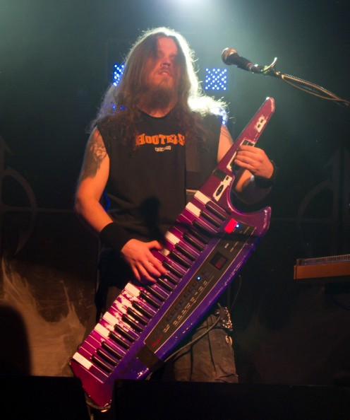 Keyboardist and vocalist Henrik Klingenberg plays live on stage in this photo.