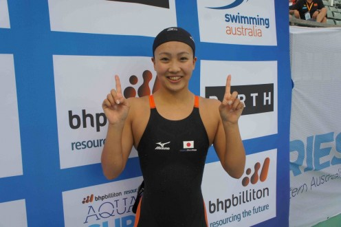 Swimmer Kanako Watanabe is happy about something.