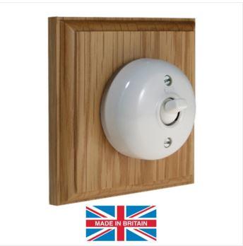 White Bakelite switch on light wood plinth