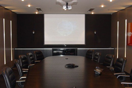 A darkened room with a screen at the front. This was used for another briefing.
