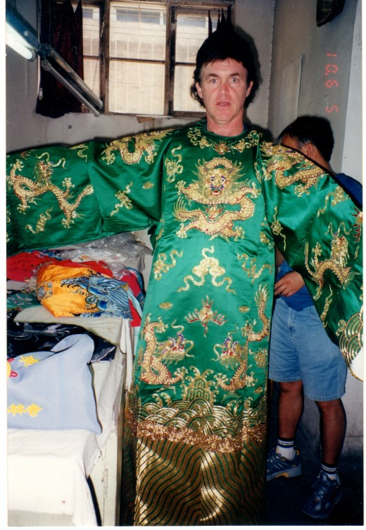 I have always admired the artistry of Beijing Opera costumes.  This one, hand-made and replete with solid gold thread, would cost about $10,000.00.  I had to at least try it on.