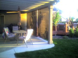 You can see how this patio employs a motorized solar shade.  Photo courtesy http://www.flickr.com/photos/windowcoverings/3208234182/