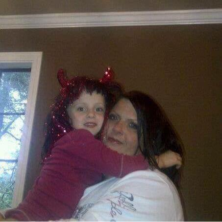 Angie with one of her three children, Annabeth Mackenzie. She also has Alexis Cameron and John Gabriel Nash.